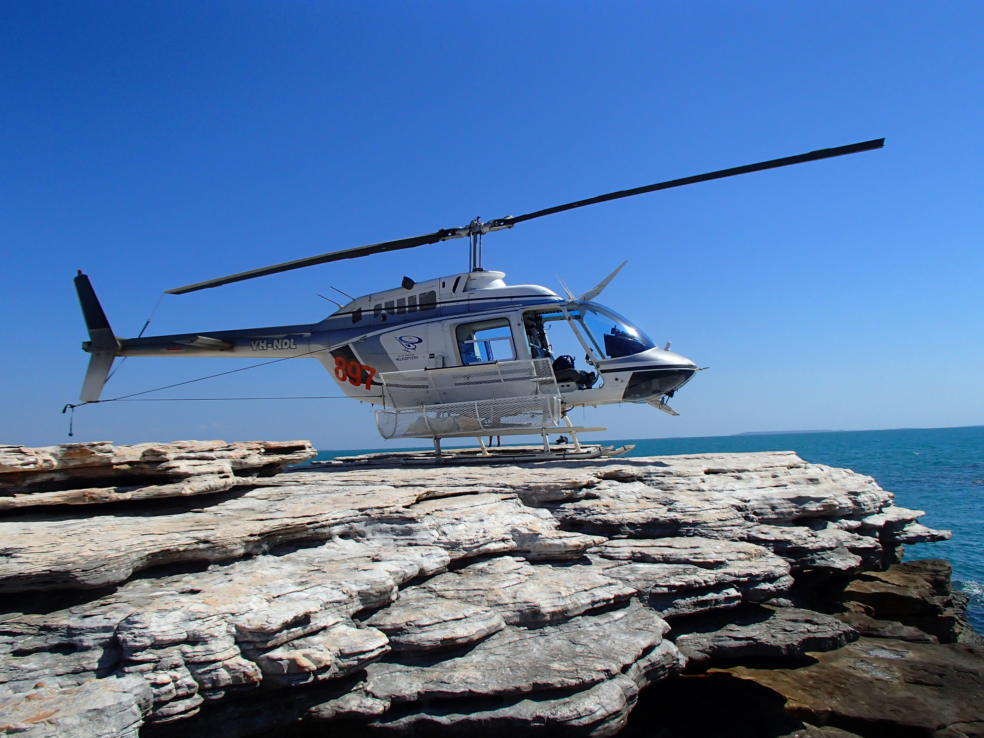 Helicopter sampling allows access to small offshore islands in the Timor Sea off the north coast of the Kimberley region in northern Western Australia. Proterozoic sedimentary rocks are essentially undeformed and offer a wide range of landing sites. - Paul Morris, Gov of WA